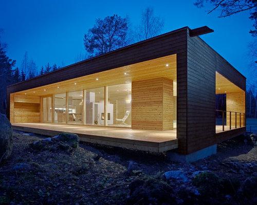 schwarzes haus mit holzfassade ideen design bilder. Black Bedroom Furniture Sets. Home Design Ideas