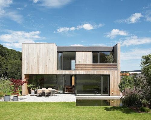 haus mit flachdach und holzfassade ideen design bilder. Black Bedroom Furniture Sets. Home Design Ideas