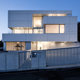 Inspiration for a huge contemporary white three-story flat roof remodel in Dusseldorf