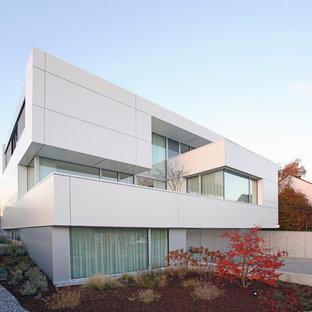 Huge contemporary white split-level mixed siding flat roof idea in Dortmund