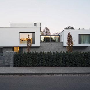 Idéer för att renovera ett mellanstort funkis flerfärgat hus, med två våningar, platt tak och blandad fasad