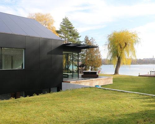 Kleines, Einstöckiges, Schwarzes Modernes Haus Mit Pultdach In München
