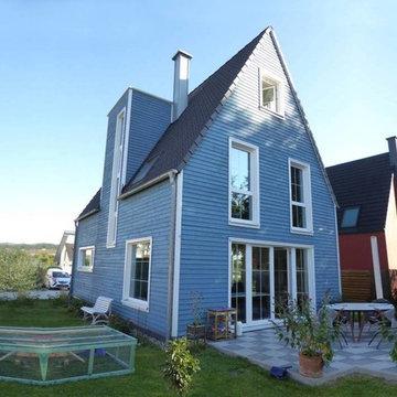 Haus Camen - Einfamilienhaus mit friesenblauer Holzfassade
