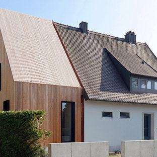 Mid-sized danish one-story wood gable roof photo in Munich