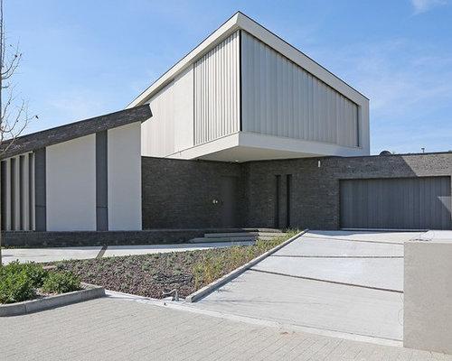 Geräumiges, Graues Modernes Haus Mit Mix Fassade Und Pultdach In Sonstige