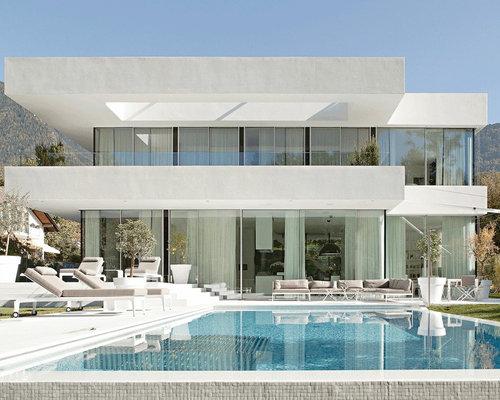 Foto e idee per facciate di case facciata di una casa for Casa di vetro contemporanea