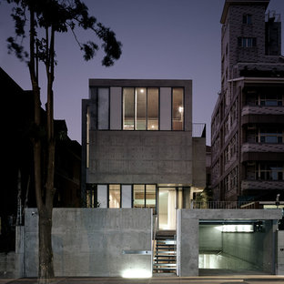 Huge urban gray two-story concrete exterior home photo in Hamburg