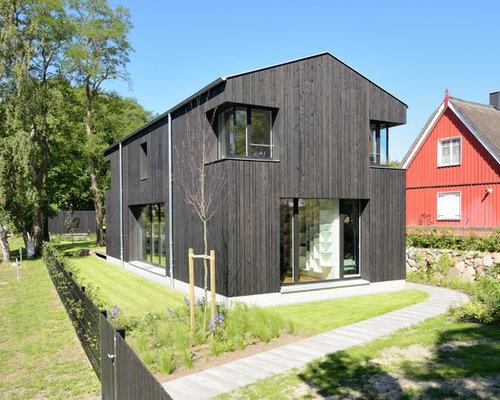 schwarzes haus und fassade mit holzfassade ideen f r die. Black Bedroom Furniture Sets. Home Design Ideas