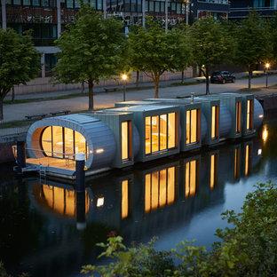 Einstöckiges, Graues, Mittelgroßes Industrial Einfamilienhaus mit Betonfassade, Flachdach und Misch-Dachdeckung in Hamburg