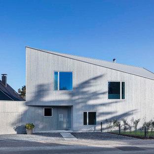 Großes, Zweistöckiges, Graues Modernes Einfamilienhaus mit Pultdach in Düsseldorf