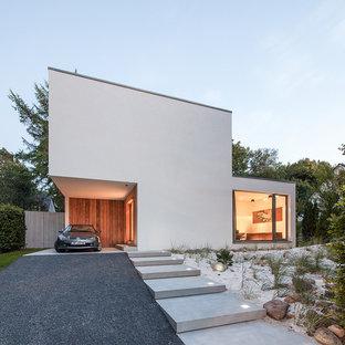 Kleines, Zweistöckiges, Weißes Modernes Einfamilienhaus mit Putzfassade und Flachdach in Hamburg