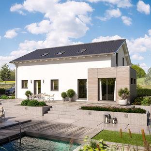 Geräumiges, Zweistöckiges, Weißes Modernes Haus mit Mix-Fassade, Satteldach und Ziegeldach