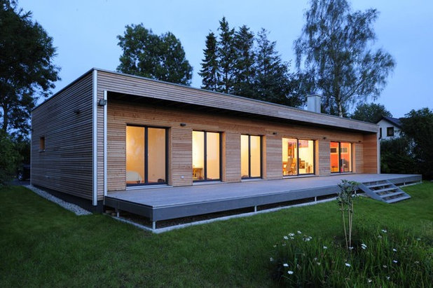 Contemporary Exterior by Bau-Fritz GmbH & Co. KG