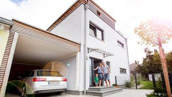 Modernes Stadthaus mit Dachterrasse in München