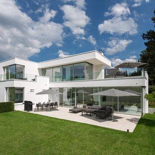 Zweistöckiges, Weißes Modernes Haus mit Flachdach und Putzfassade in Essen