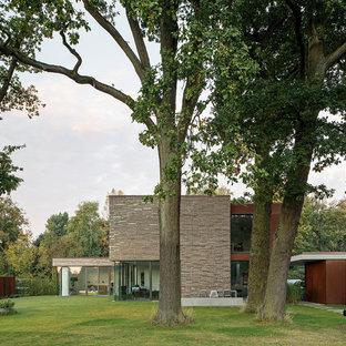 Großes, Zweistöckiges Modernes Einfamilienhaus mit Mix-Fassade und Flachdach in Köln