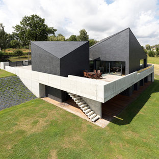 Large contemporary gray two-story house exterior idea in Other