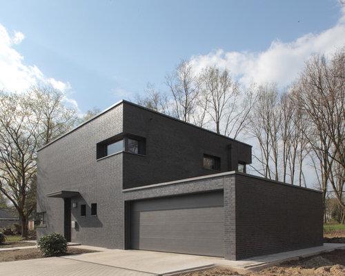 schwarzes haus mit backsteinfassade ideen design bilder. Black Bedroom Furniture Sets. Home Design Ideas