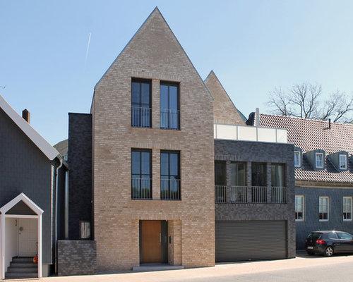 Haus mit satteldach simple satteldach und flachdach for Klinker haus modern