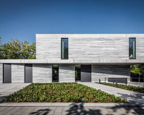 Zweistöckiges, Graues, Mittelgroßes Modernes Haus Mit Steinfassade Und  Flachdach In Köln