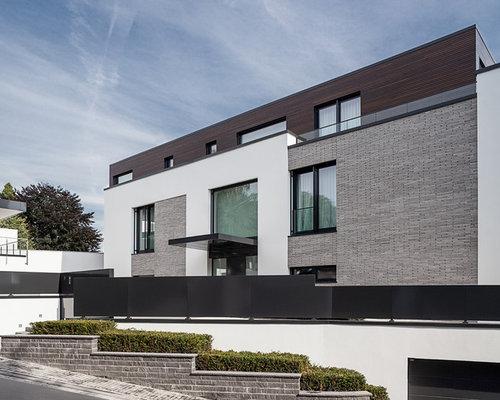 Moderne h user und fassaden mit steinfassade ideen f r for Modernes haus mit vordach