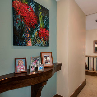 Mid-sized arts and crafts hallway in Denver with blue walls and carpet.