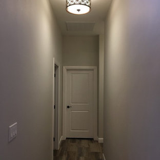 Inspiration for a mid-sized timeless porcelain floor hallway remodel in Austin with gray walls