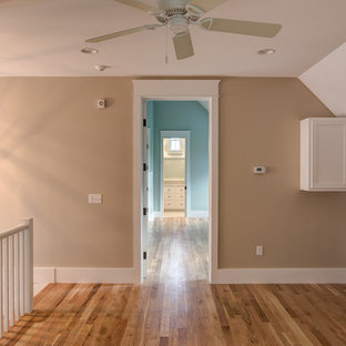 Design ideas for a small beach style hallway in Miami with beige walls and light hardwood floors.