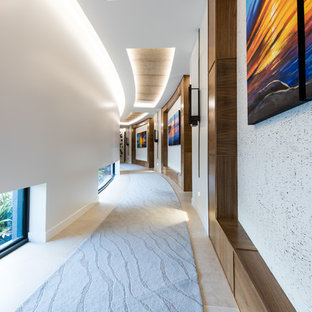 This is an example of a contemporary hallway in Sunshine Coast with white walls and beige floor.