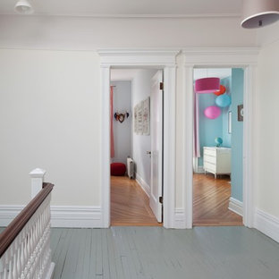 Hallway - large traditional painted wood floor and blue floor hallway idea in New York with white walls