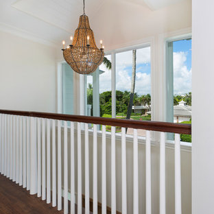 Design ideas for a mid-sized beach style hallway in Other with beige walls, medium hardwood floors and brown floor.