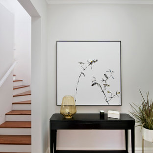 Mid-sized transitional hallway in Sydney with grey walls and brown floor.