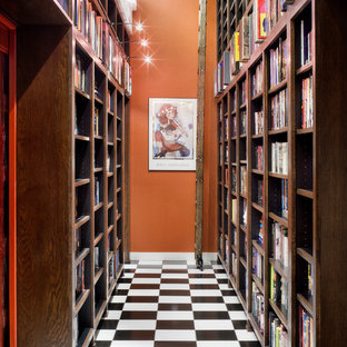 Inspiration for a contemporary porcelain floor hallway remodel in Austin with orange walls