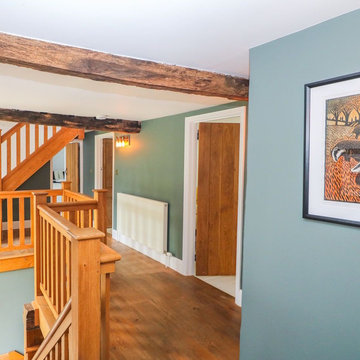 A cool green landing for a beautiful Arts and Crafts style staircase