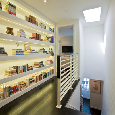 Inspiration for a contemporary dark wood floor hallway remodel in DC Metro with white walls
