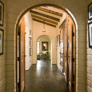 Inspiration for a mid-sized southwestern dark wood floor and brown floor hallway remodel in Santa Barbara with white walls