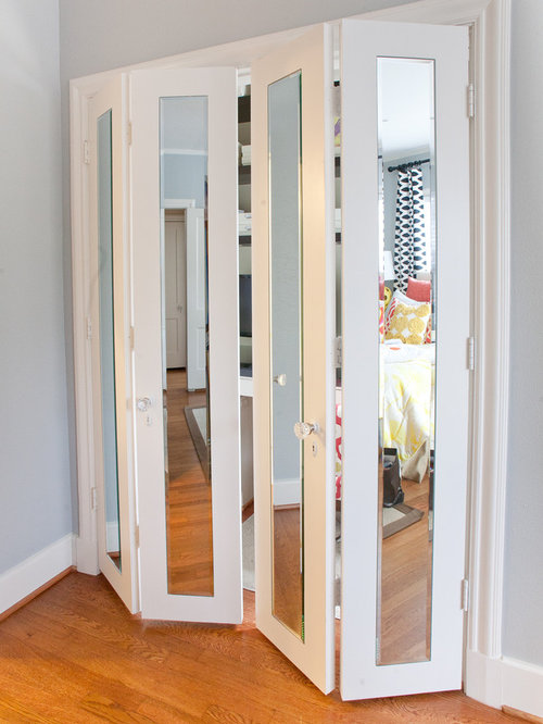 Inspiration for a mid-sized contemporary medium tone wood floor and brown floor hallway remodel & Masonite Door | Houzz