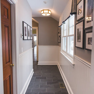 Mid-sized transitional slate floor and gray floor hallway photo in New York with gray walls