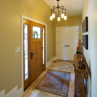 Small elegant porcelain floor hallway photo in Chicago with yellow walls