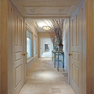 Example of a huge classic limestone floor hallway design in New York with beige walls