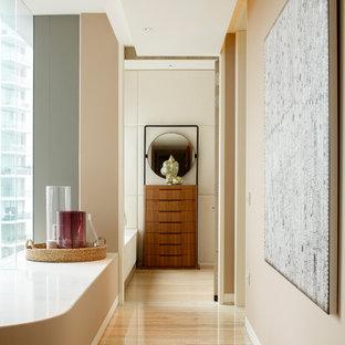 Ispirazione per un ingresso o corridoio etnico con pareti beige