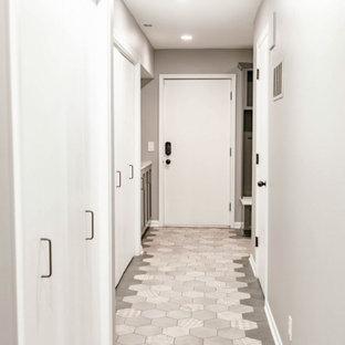 На фото: коридор среднего размера в современном стиле с серыми стенами, мраморным полом и серым полом с