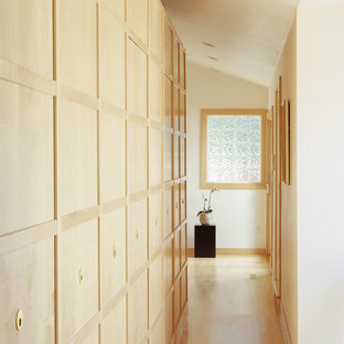 Design ideas for an asian hallway in San Francisco with white walls and light hardwood floors.