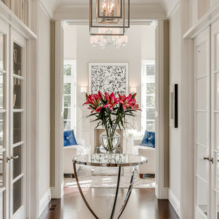 Inspiration for a timeless dark wood floor and brown floor hallway remodel in San Francisco with beige walls