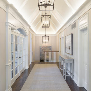Design ideas for a beach style hallway in Toronto with beige walls, dark hardwood floors and brown floor.