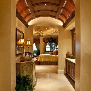 Example of a tuscan beige floor hallway design in Miami with beige walls