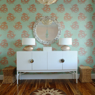 Inspiration for a beach style hallway in Philadelphia with multi-coloured walls and medium hardwood floors.