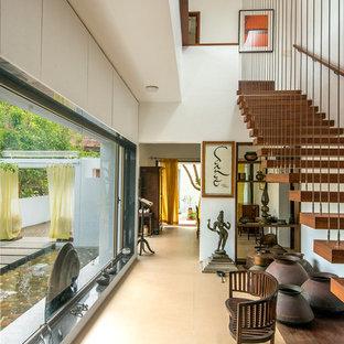 Foto de recibidores y pasillos de estilo zen, de tamaño medio, con paredes blancas