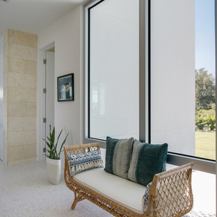 Photo of a mid-sized beach style hallway in Tampa with white walls, concrete floors and multi-coloured floor.