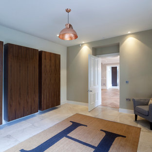 Example of a large trendy limestone floor hallway design in Cheshire with green walls